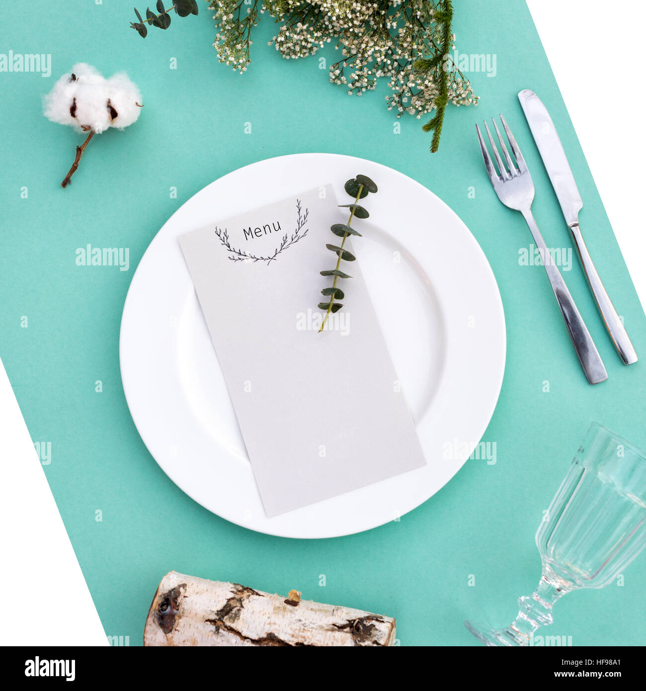 Dinner menu for a wedding or luxury evening meal. Table setting from above. Elegant empty plate, cutlery, glass - Stock Image