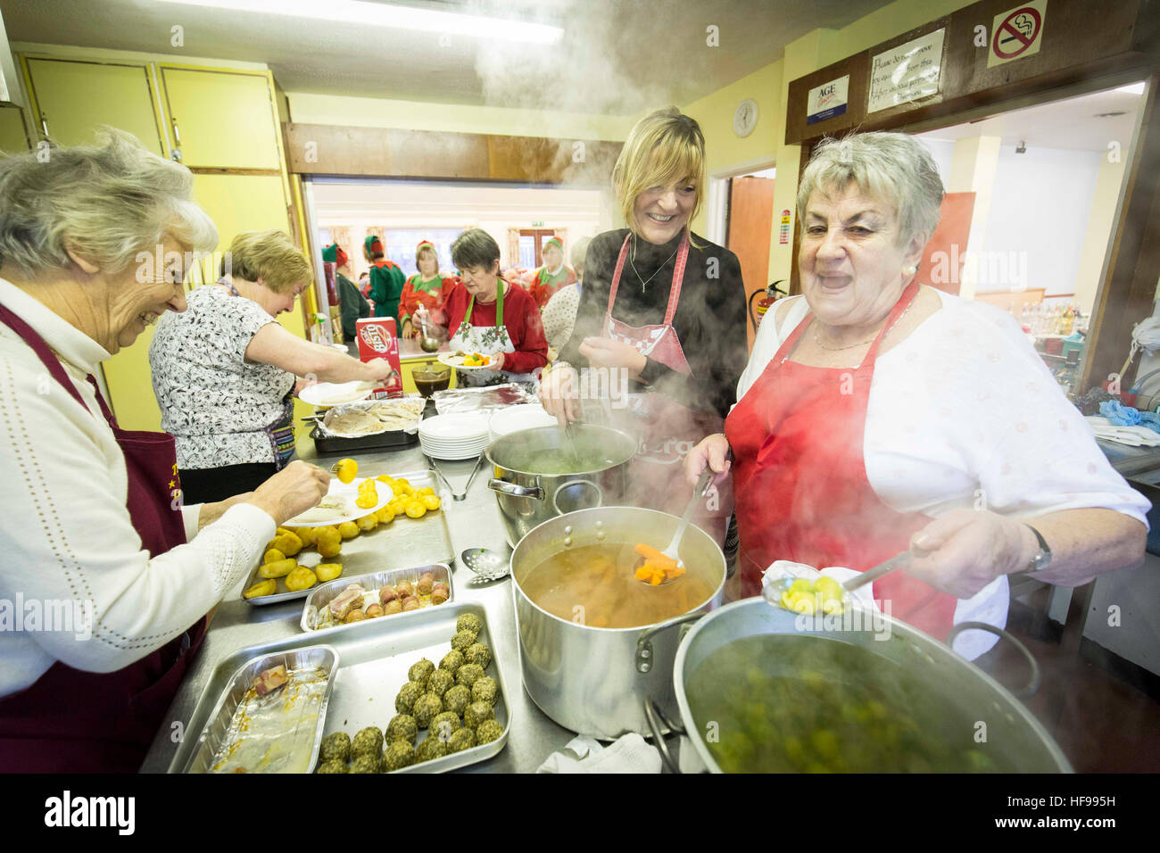 Old people enjoy a Christmas party at Holy Trinity Church Hall , Southport - Stock Image