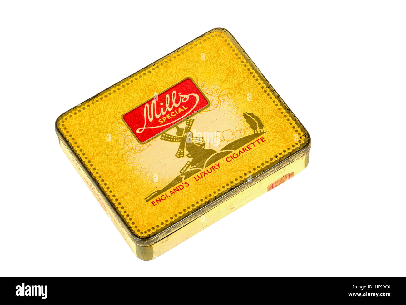 Studio shot vintage yellow metal Mills Special luxury cigarette box on white background - Stock Image