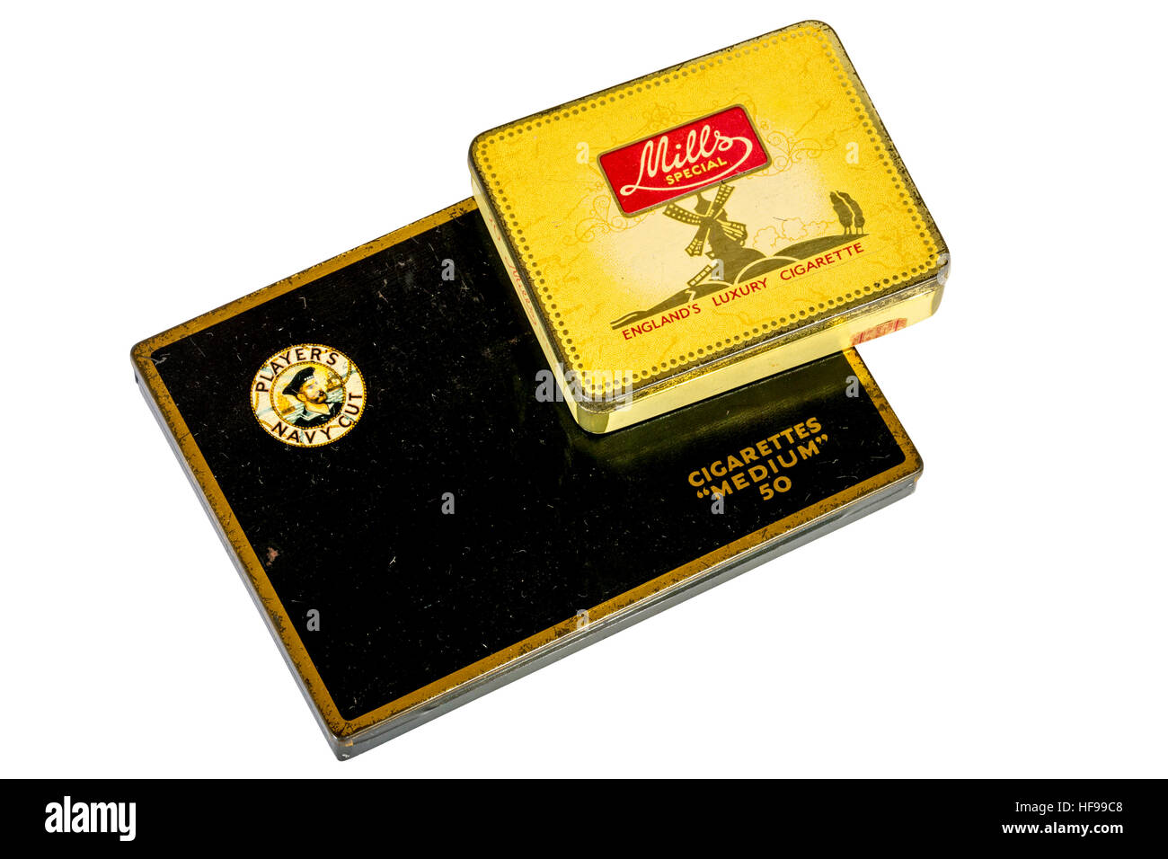 Studio shot of yellow Mills Special and black Players Navy Cut metal cigarette tins isolated on white - Stock Image