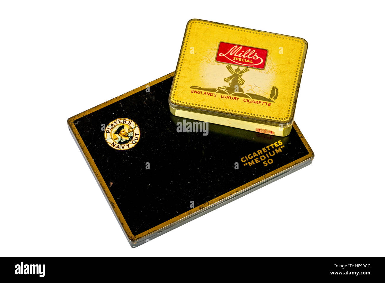 Studio shot of yellow Mills Special and black Players Navy Cut metal cigarette tins isolated - Stock Image