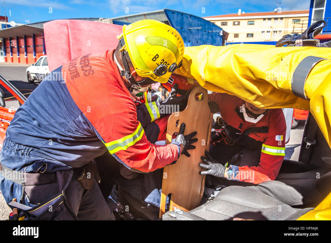 firemen during a car accident simulation - Stock Image
