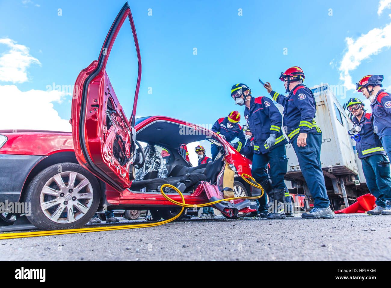 firemen during a car accident simulation Stock Photo: 129898376 - Alamy