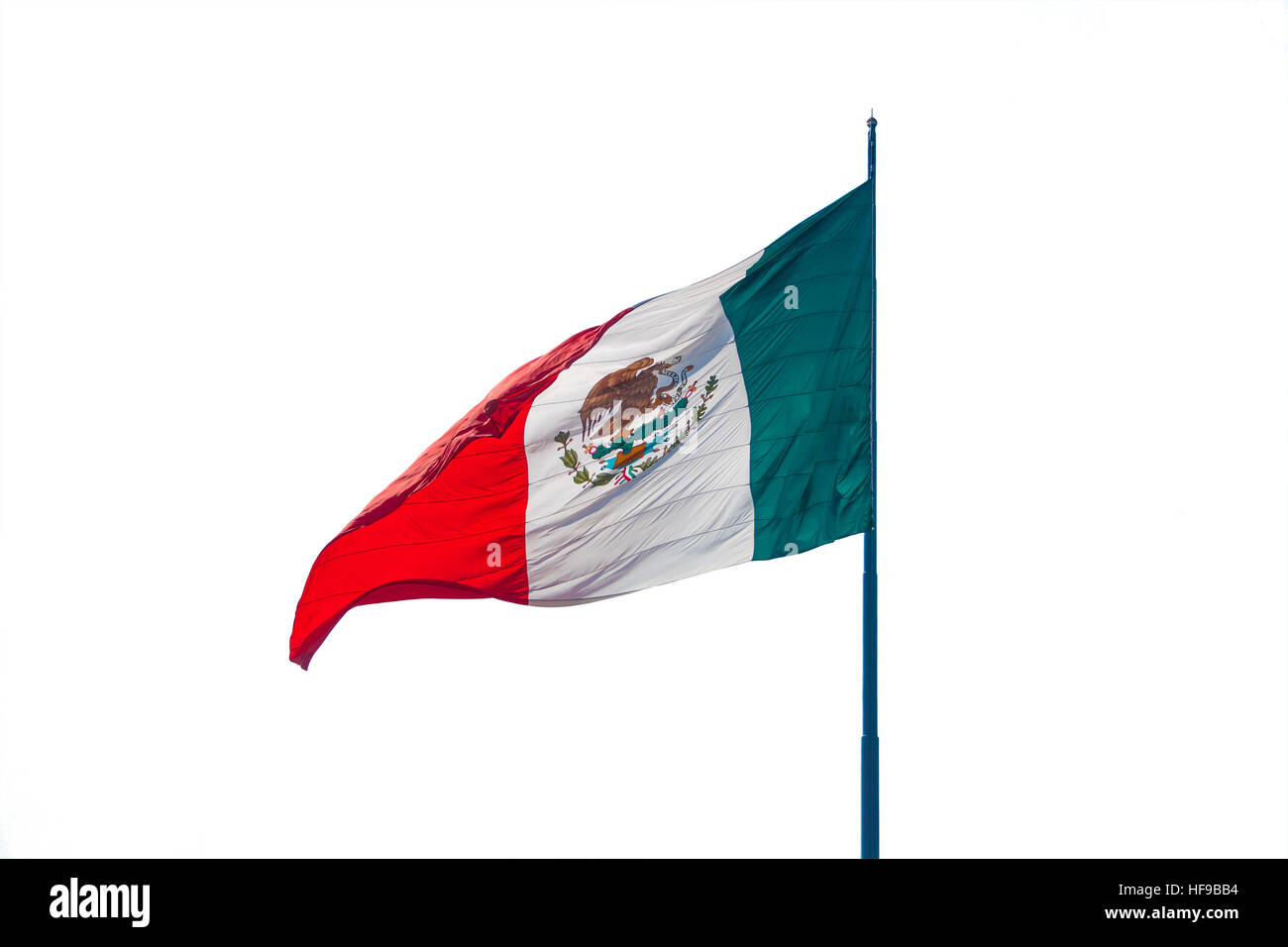 Flag of Mexico in the wind isolated over white background. - Stock Image
