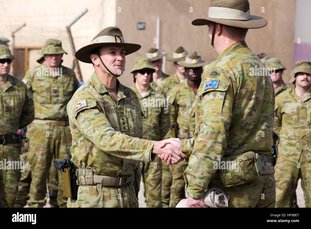 Australian officers shake hands during a transfer of authority ceremony at Camp Taji December 8, 2016 near Al Taji, - Stock Image