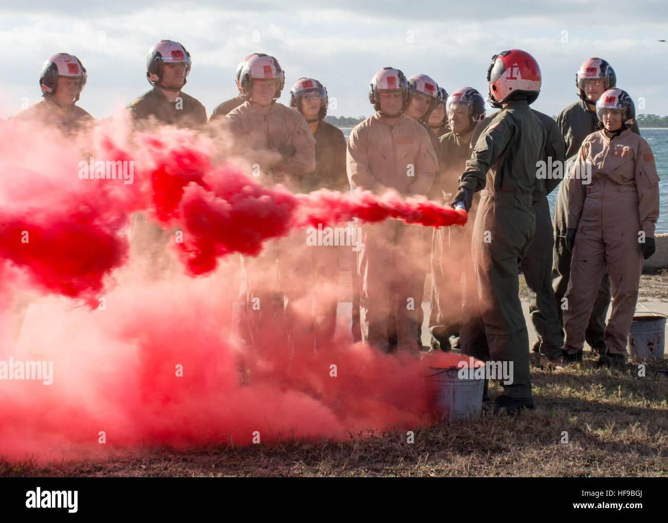 Students at the Naval Survival Training Institute learn to use a MK-124 signal flare December 6, 2016 in Pensacola, - Stock Image
