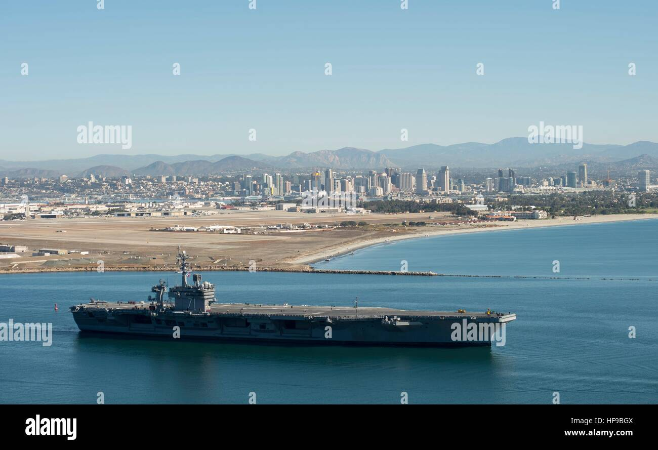 The USN Nimitz-class aircraft carrier USS Theodore Roosevelt departs the Air Station North Island December 19, 2016 - Stock Image