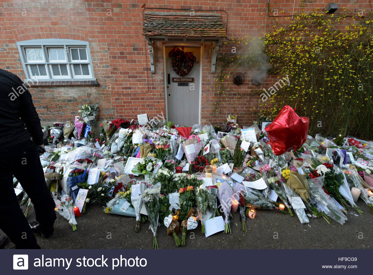 Flowers Candles And Words Of Sympathy Were Left Outside George