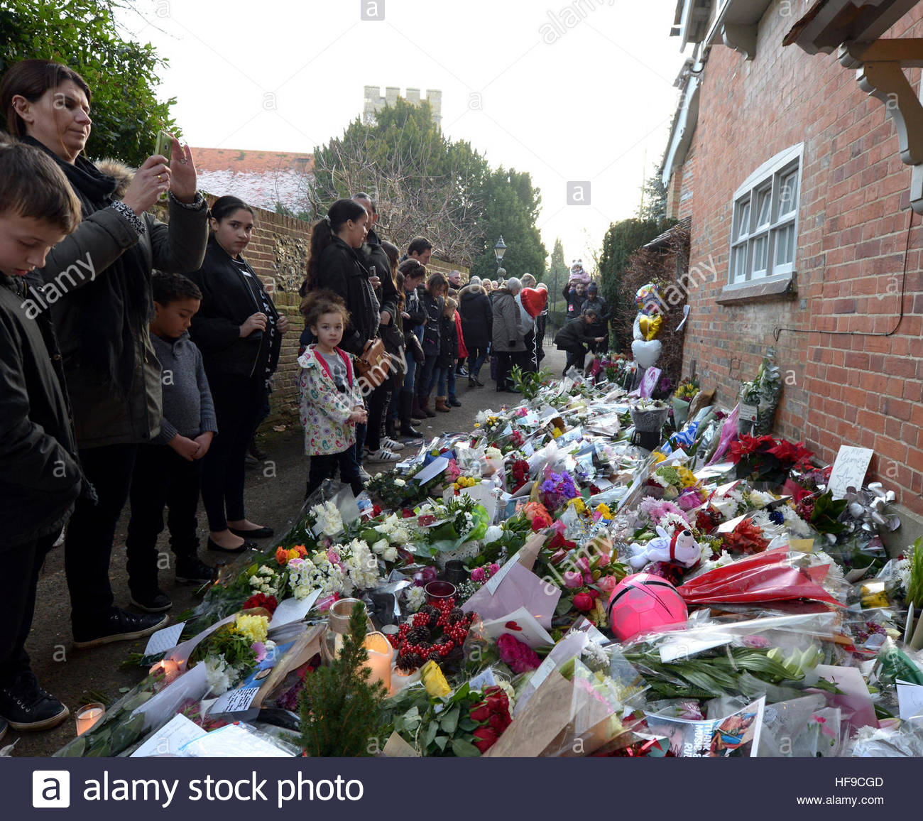 Flowers candles and words of sympathy were left outside george flowers candles and words of sympathy were left outside george michaels home in goring on thames where the star passed away izmirmasajfo Images