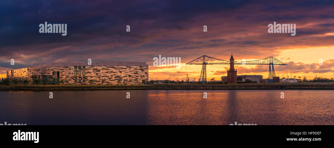 View across Middlesborough at sunset with the Transporter Bridge on the right and Middlesborough College on the - Stock Image