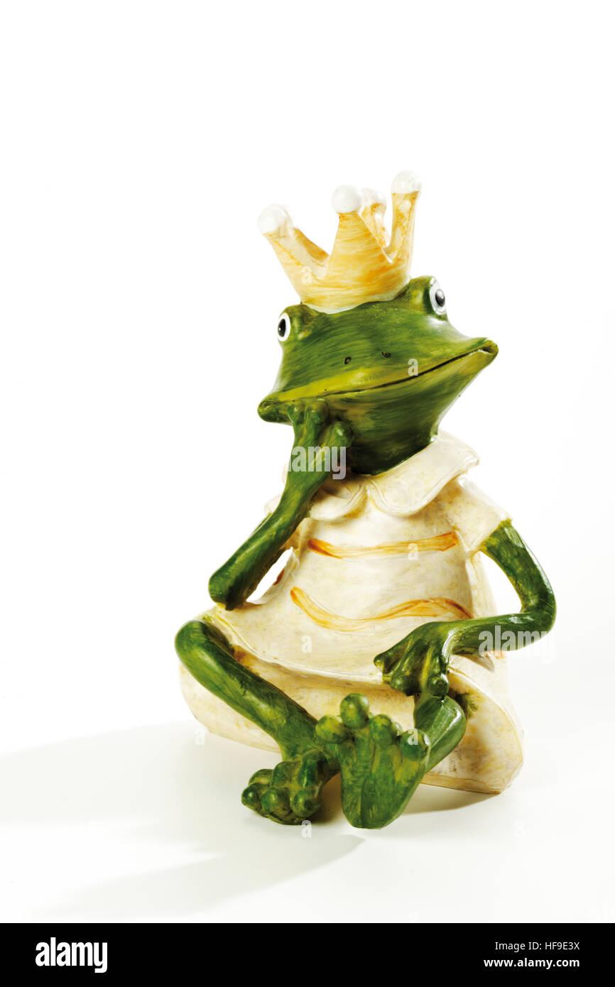 Figurine, frog wearing crown, sitting, contemplating - Stock Image