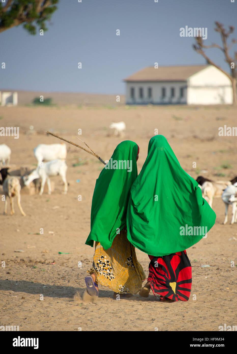 Two young Somali girls walking to school in rural Somalia Stock Photo
