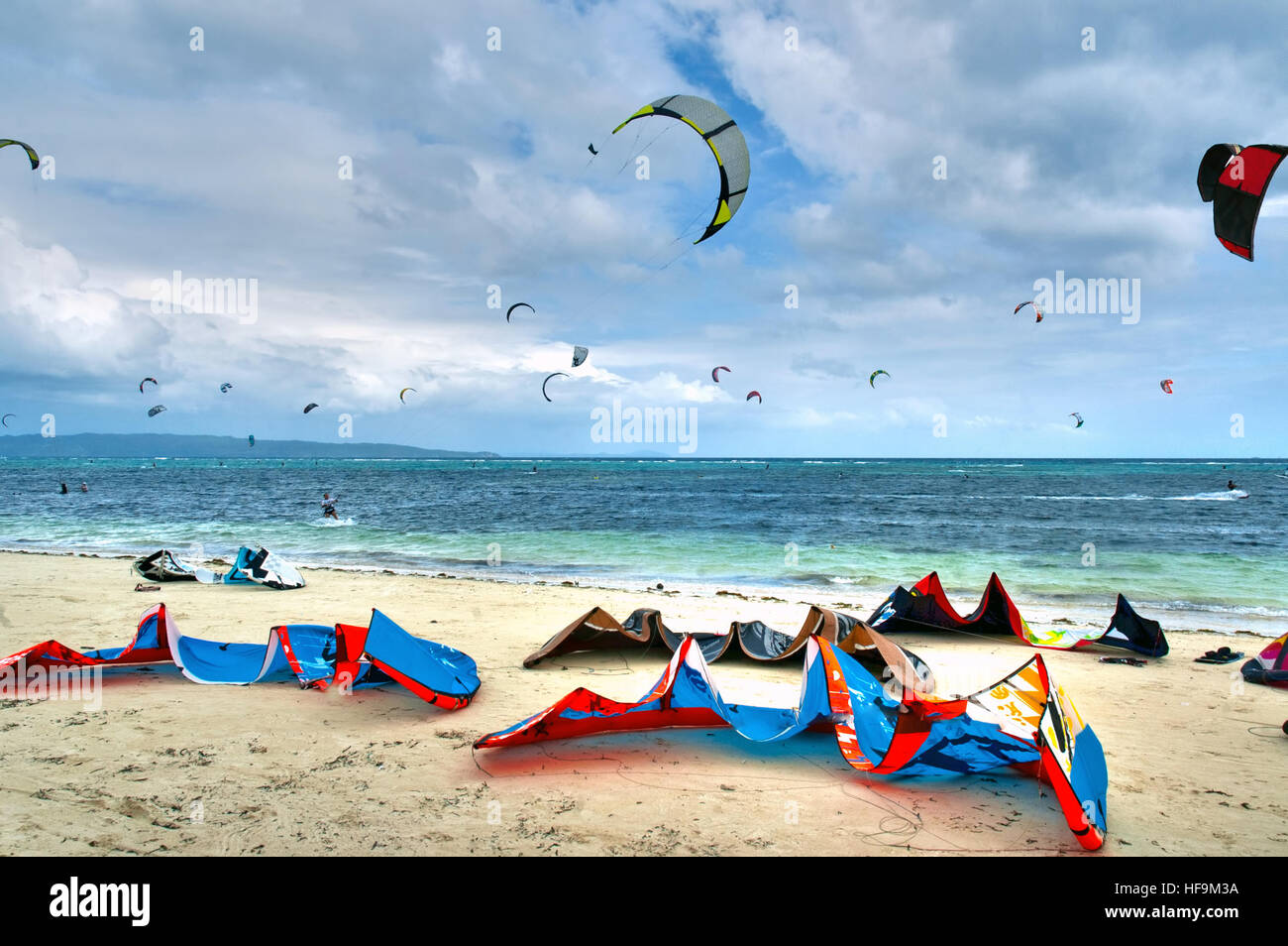 Colorful Kite surfing equipment laying  on a white sand beach in Boracay the Philippines - Stock Image