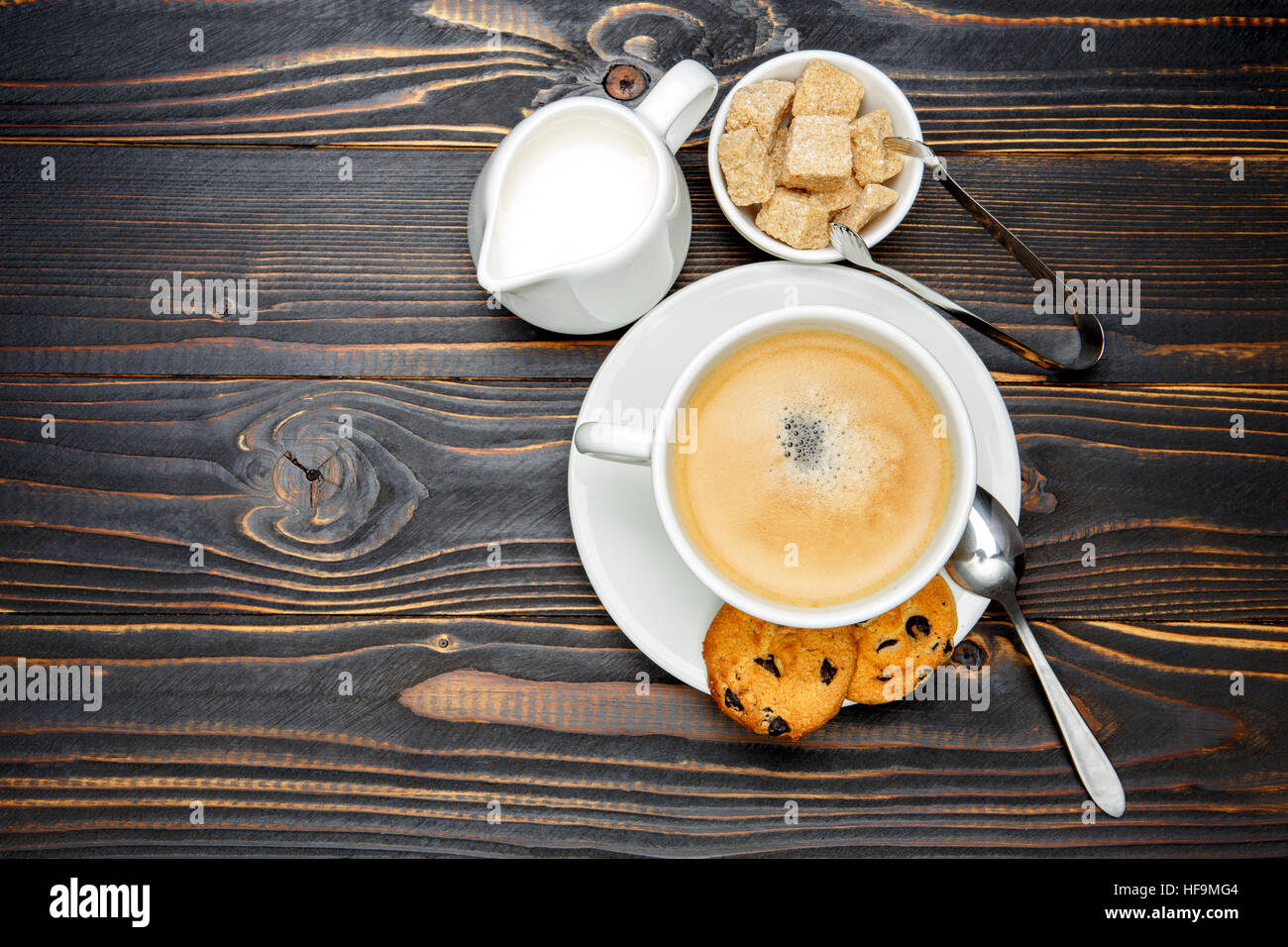 fresh cookies and coffee on wooden background - Stock Image