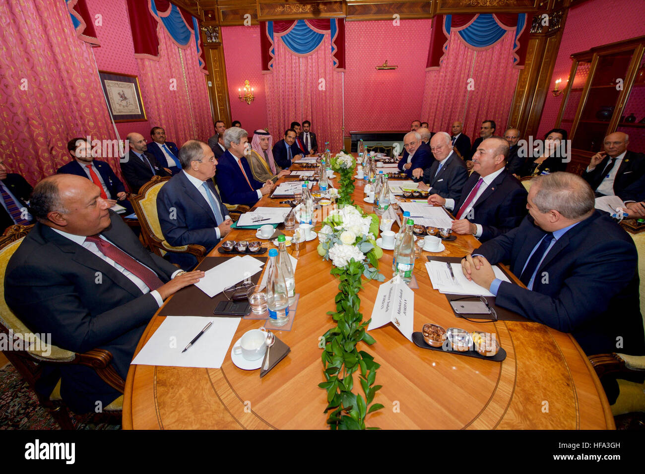 U.S. Secretary of State John Kerry sits with the Foreign Ministers from, clockwise, left to right, Egypt, Russia, - Stock Image