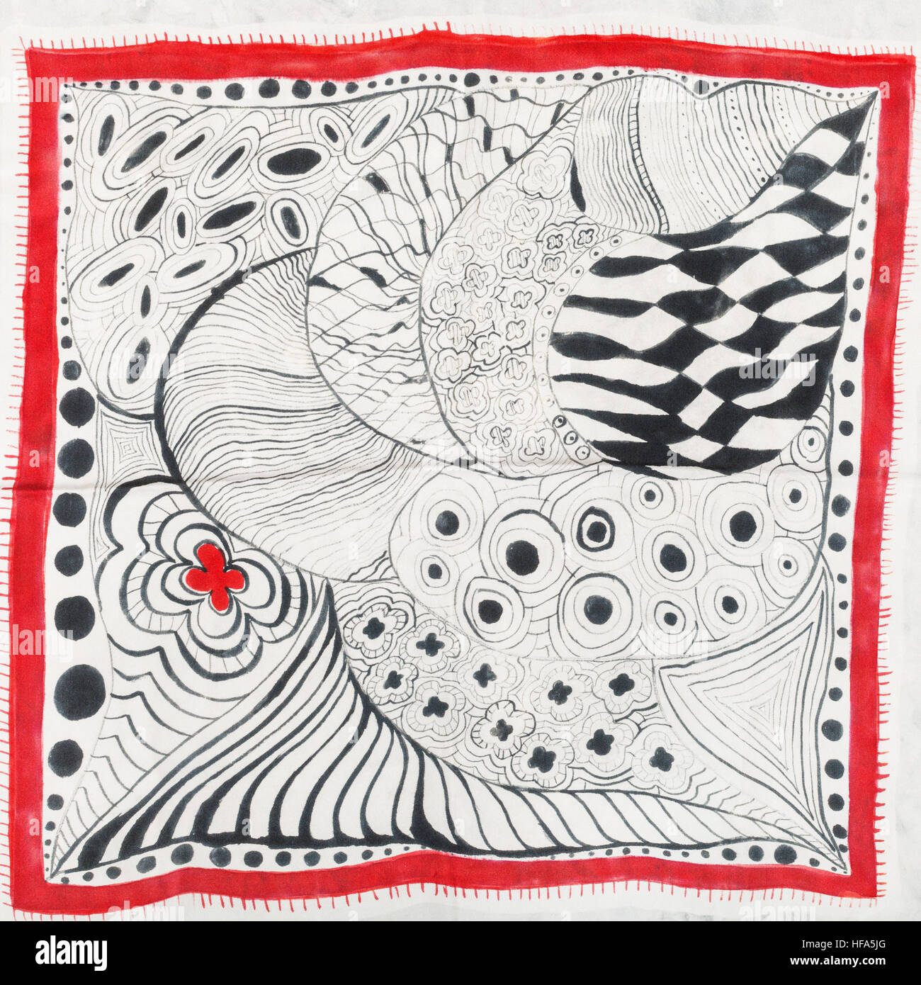 hand painted silk batik - abstract pattern with red flower and black curved lines on white cloth of head scarf - Stock Image