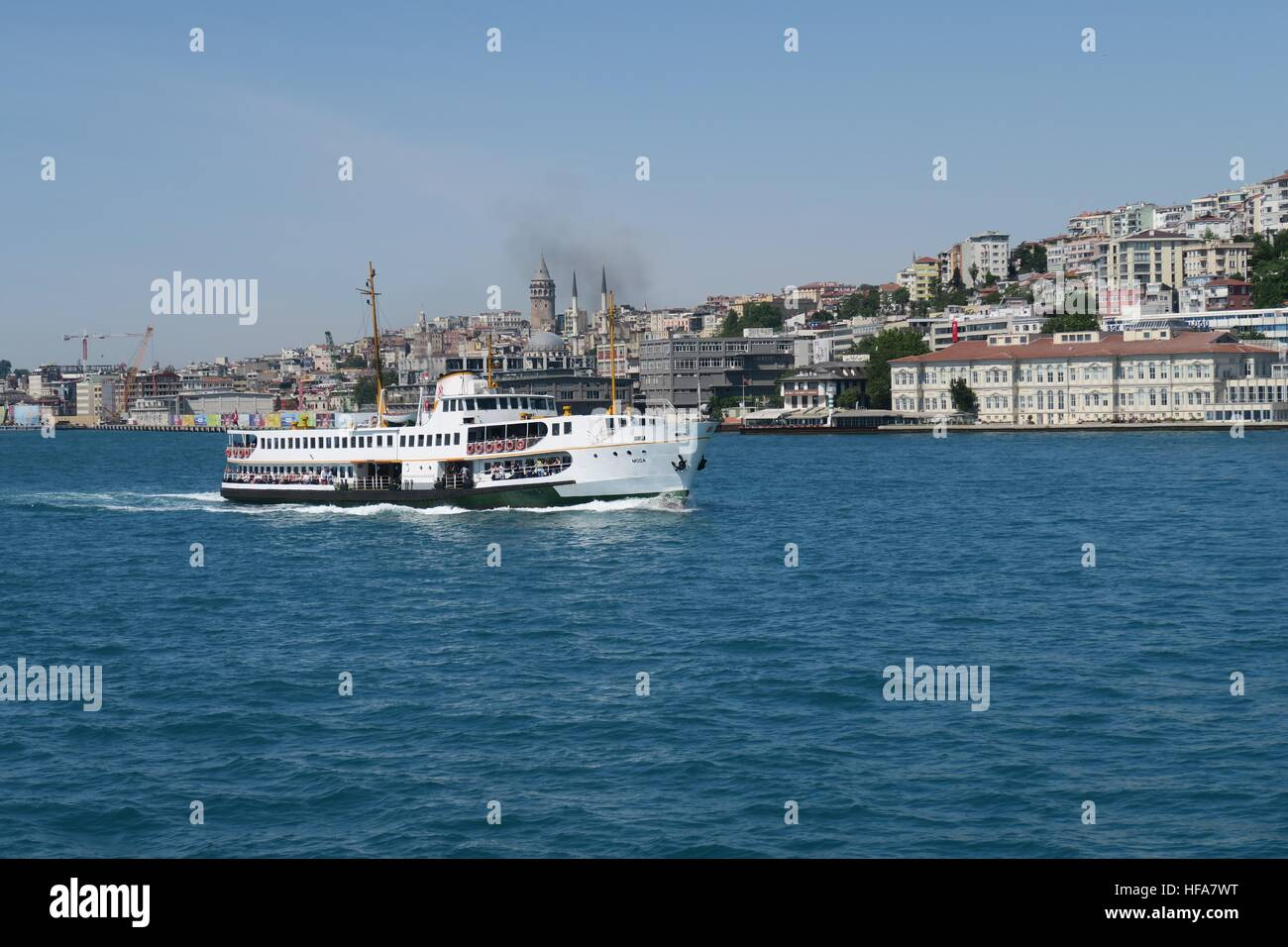 Bosphorus Ferry as seen from the Asian Side of Istanbul, with Galata and Beyoglu - Stock Image