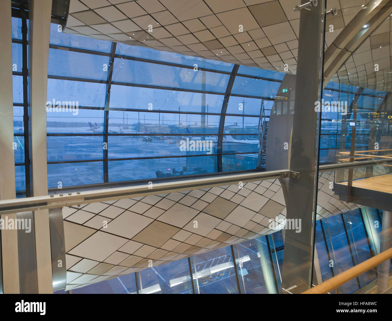 New airport terminal in Oslo Norway 2016, looking out at dreary weather for flying, dark, snow, sleet, normal winter - Stock Image