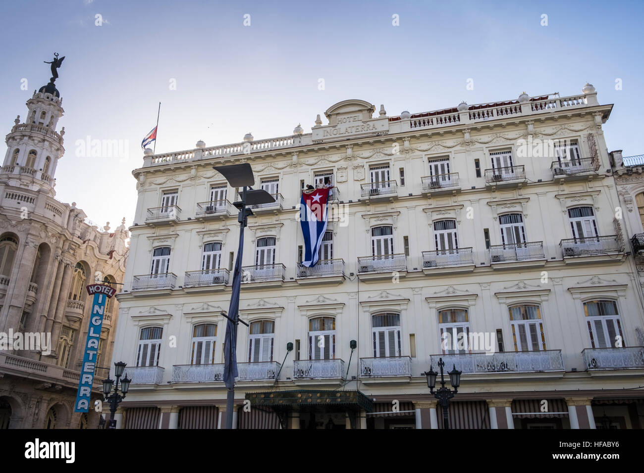 Hanging a giant Cuban flag on the front of the Hotel Inglaterra on the day Fidel Castros death was announced, La - Stock Image