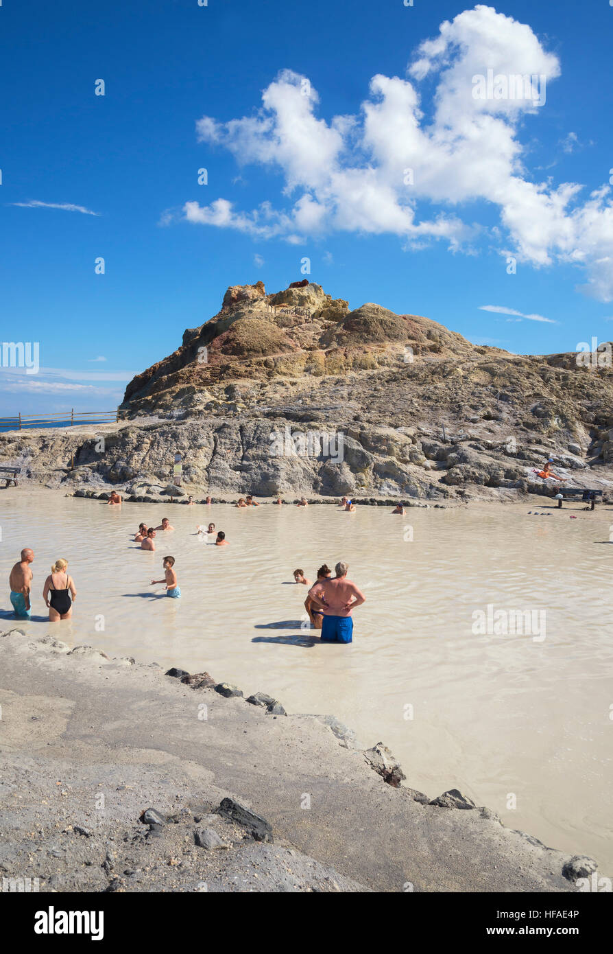 Bathers enjoying the therapeutic benefits of the volcanic mud in the hot spring pool, Vulcano Island, Aeolian Islands, - Stock Image