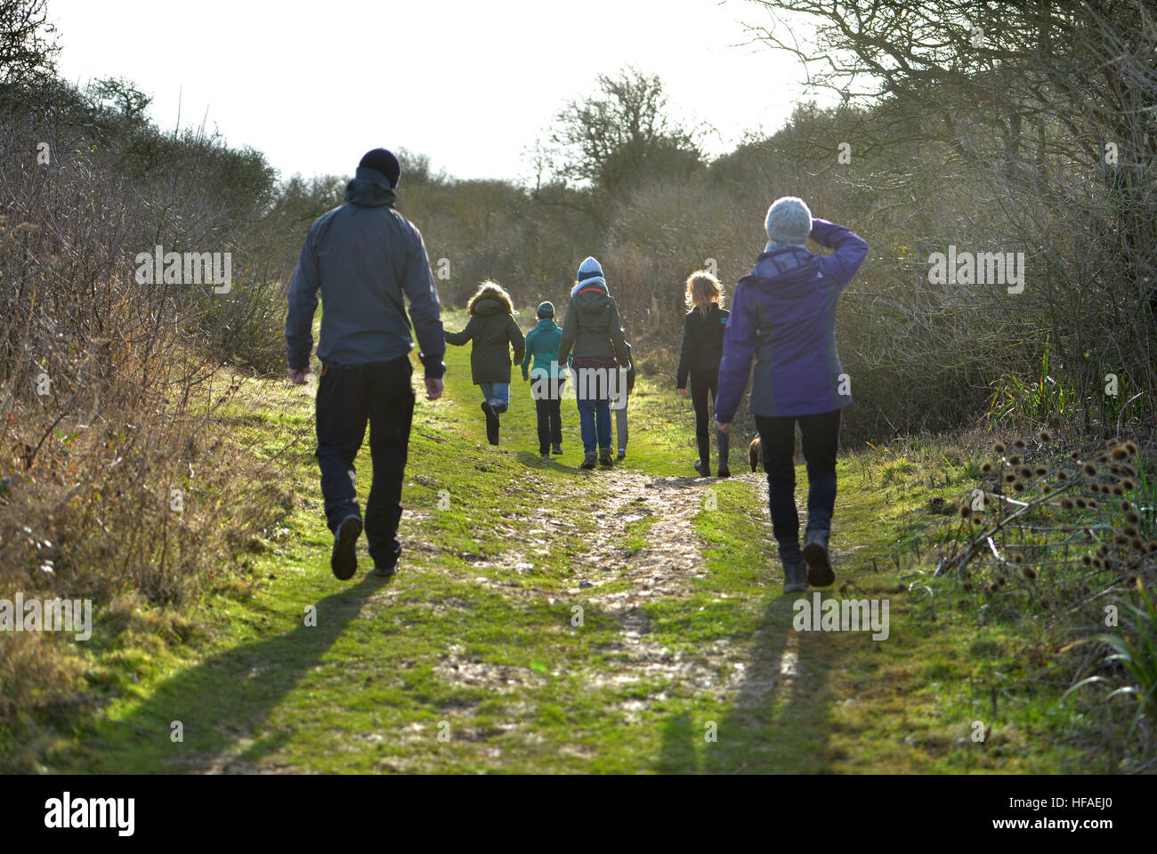 Family on a winter walk in the South Downs, Sussex - Stock Image