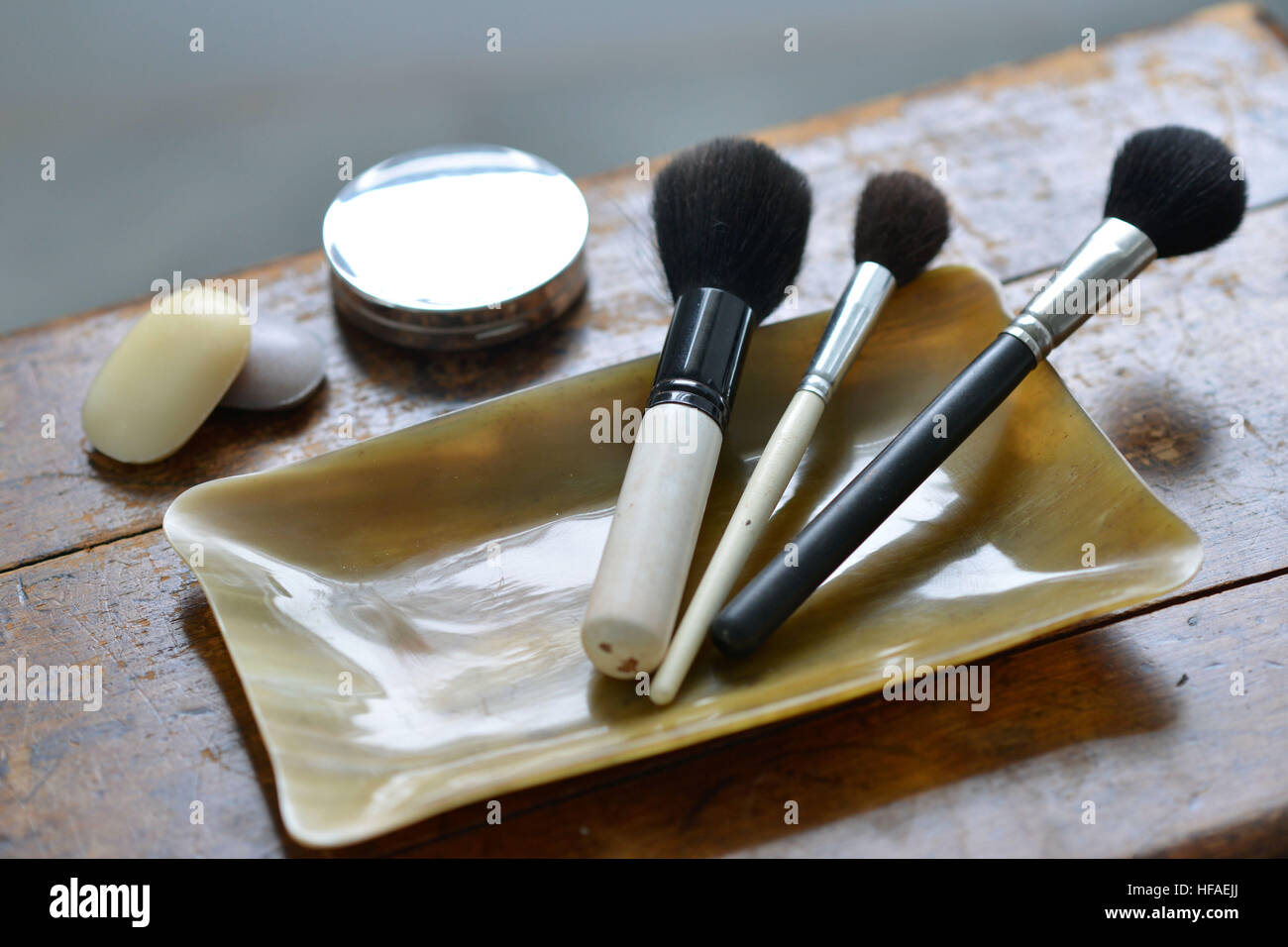 Makeup brushes in a horn container, luxury bathroom - Stock Image