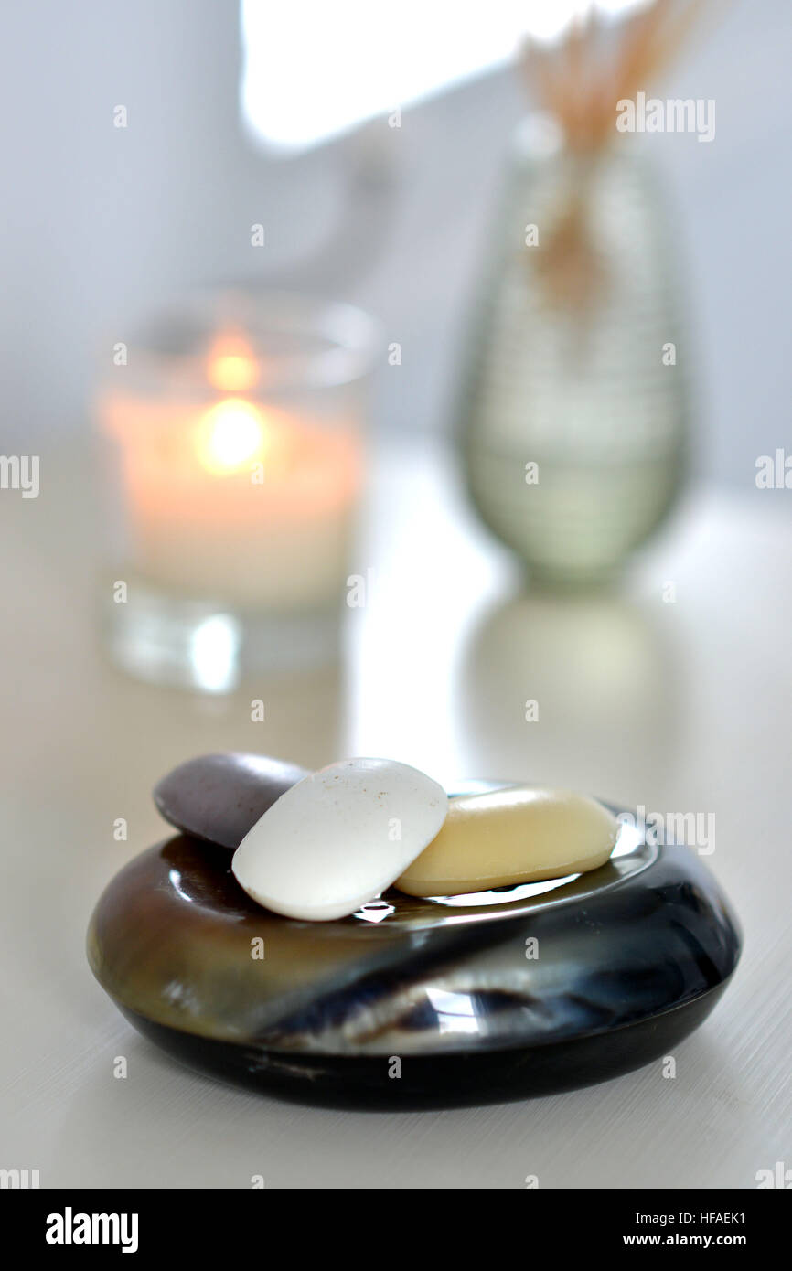 Soaps on a natural horn soap dish - Stock Image