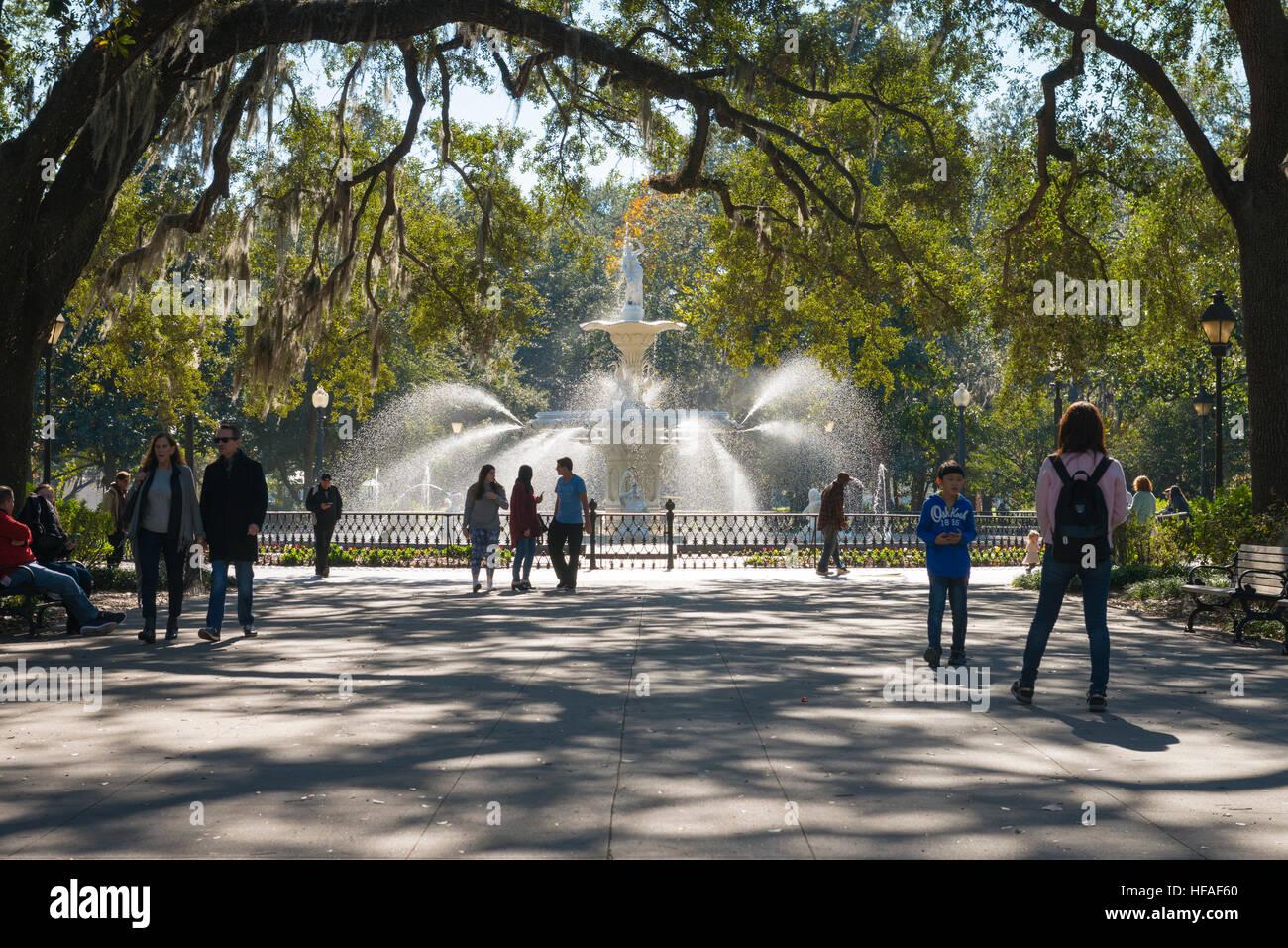 USA Georgia Savannah Forsyth Park fountain pond trees tourists sunlight - Stock Image