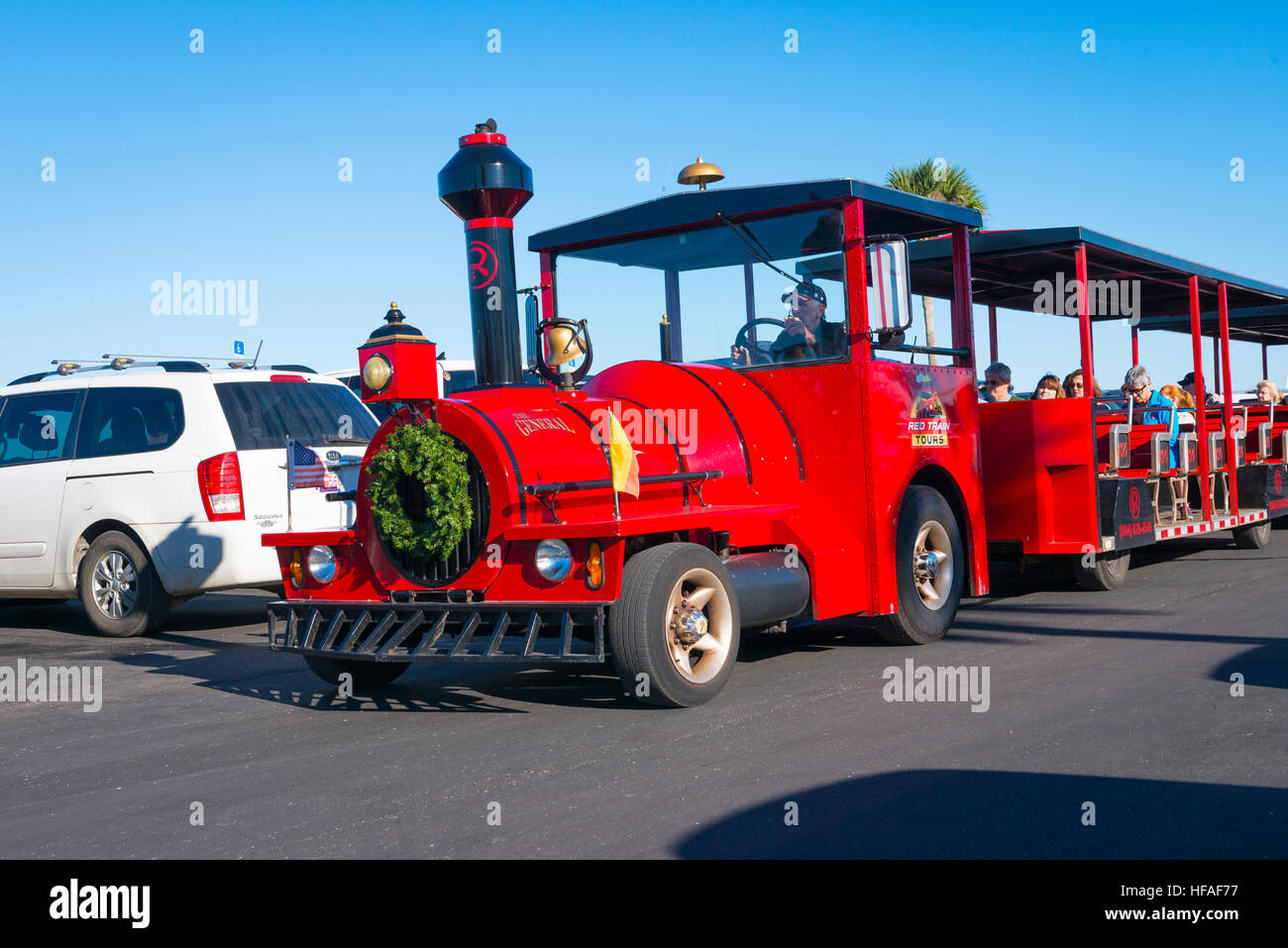 USA Florida St Augustine tourist road street Red Train Tours replica old engine - Stock Image