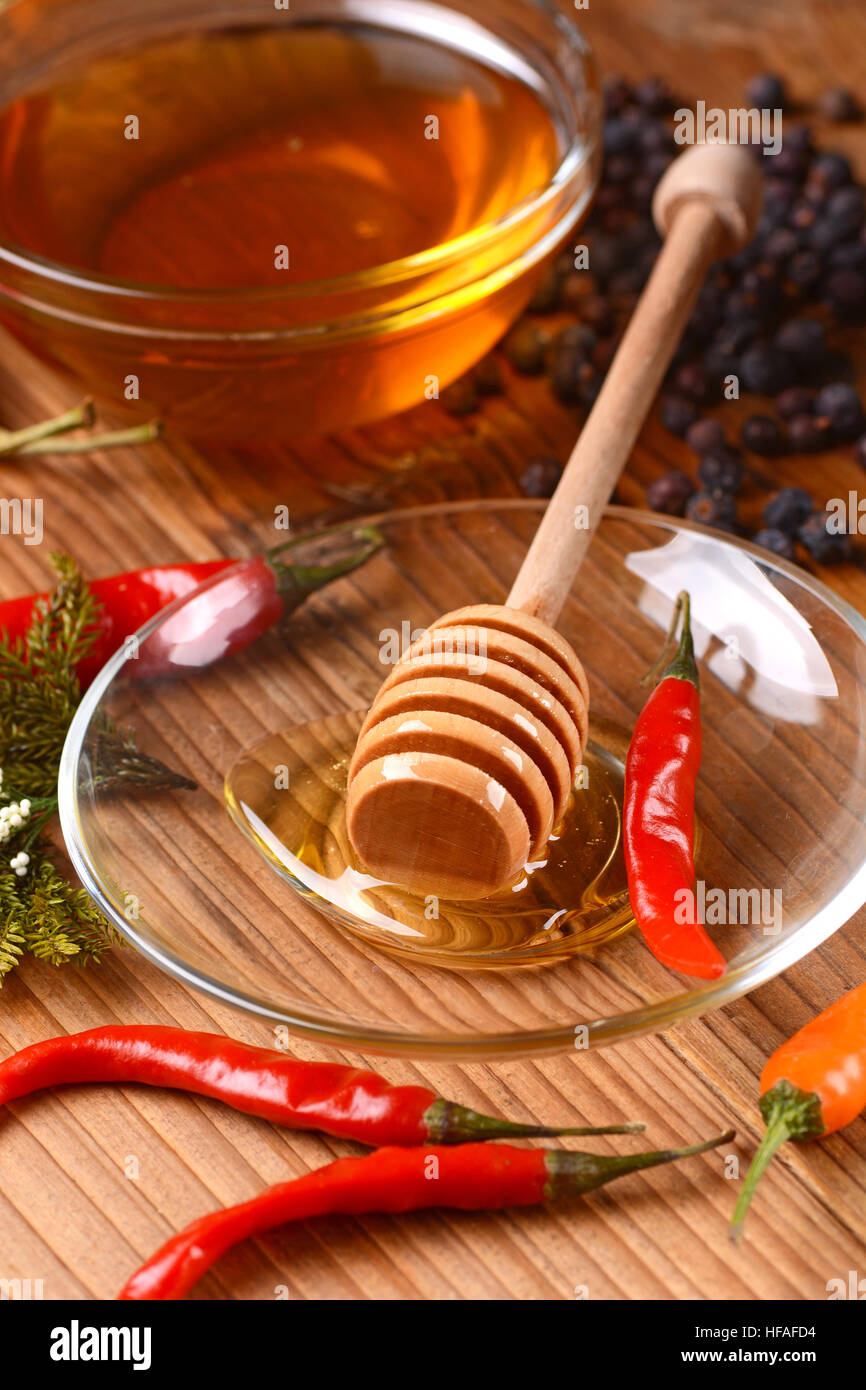 honey chilli pepper in glass bowl - Stock Image
