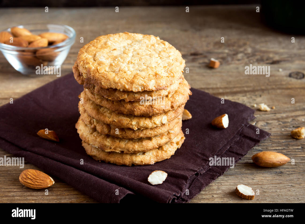 Homemade almond cookies on wooden table with copy space - healthy homemade vegan vegetarian pastry with almonds - Stock Image