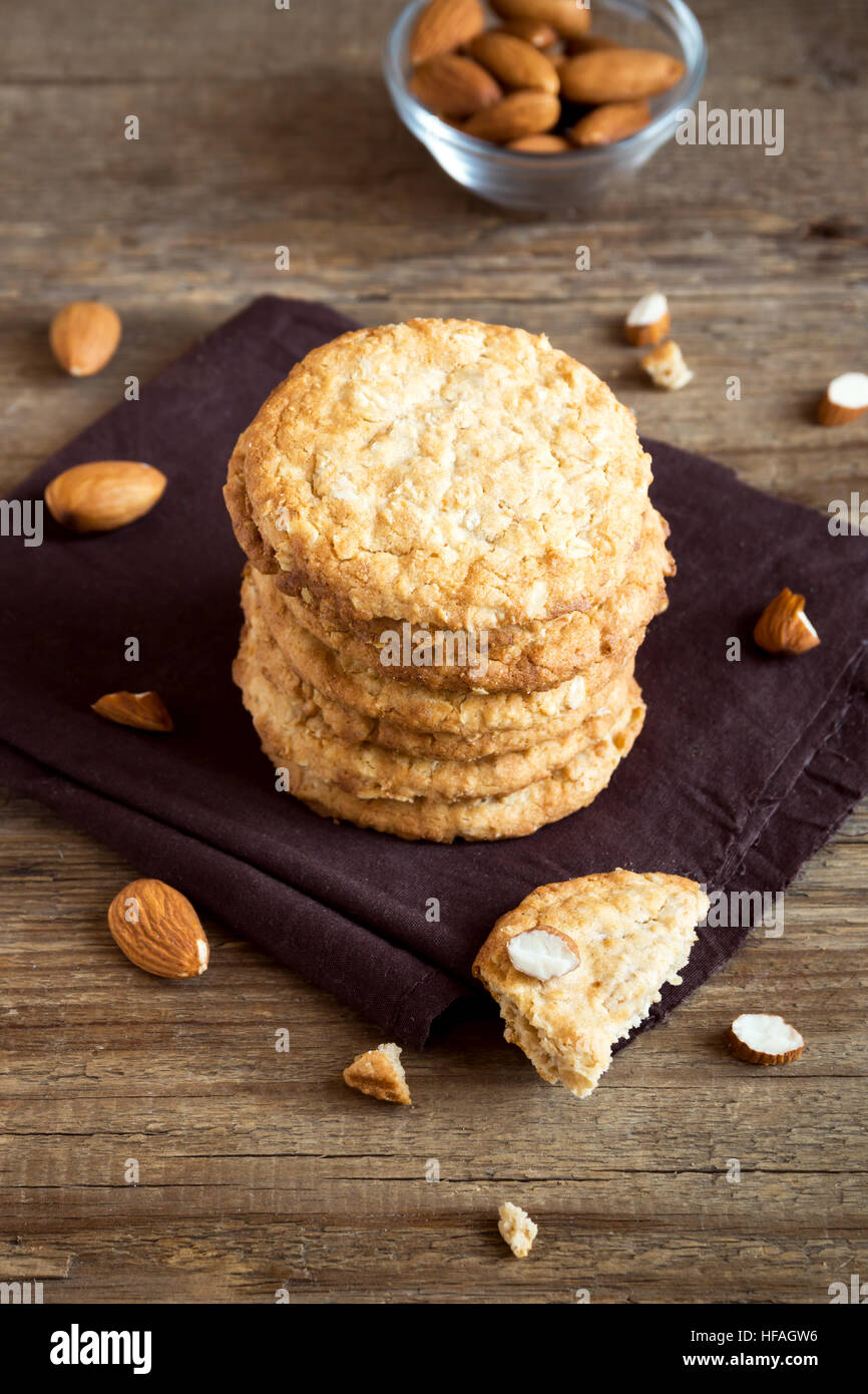 Homemade almond cookies on wooden table with copy space - healthy homemade vegan vegetarian pastry with almonds Stock Photo