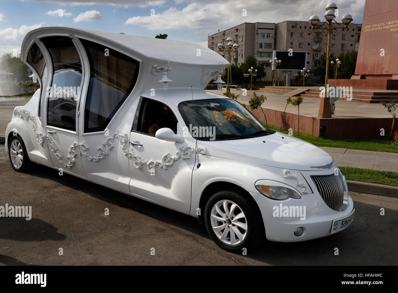 Elaborate limousine made to look like a carriage for a wedding party at Ordabassy square fountain Shymkent Kazakhstan - Stock Image