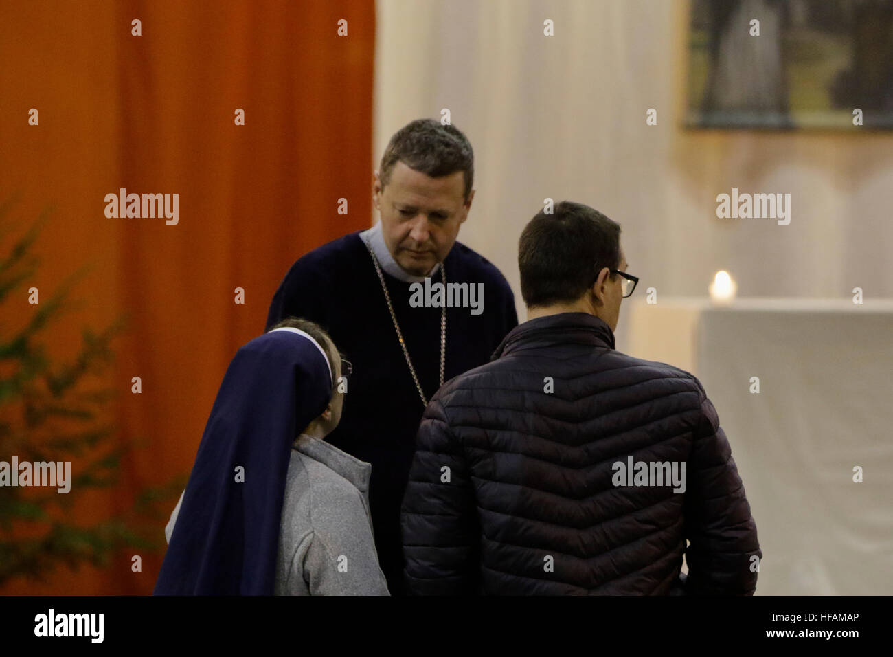 Riga, Latvia. 28th Dec, 2016. Alain de Raemy (centre), the bishop of the Roman Catholic Diocese of Saint-Die in - Stock Image