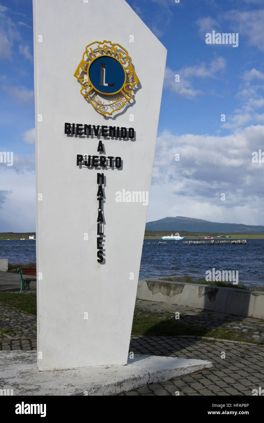 Lions Club welcome marker on waterfront, Puerto Natales, Patagonia, Chile - Stock Image