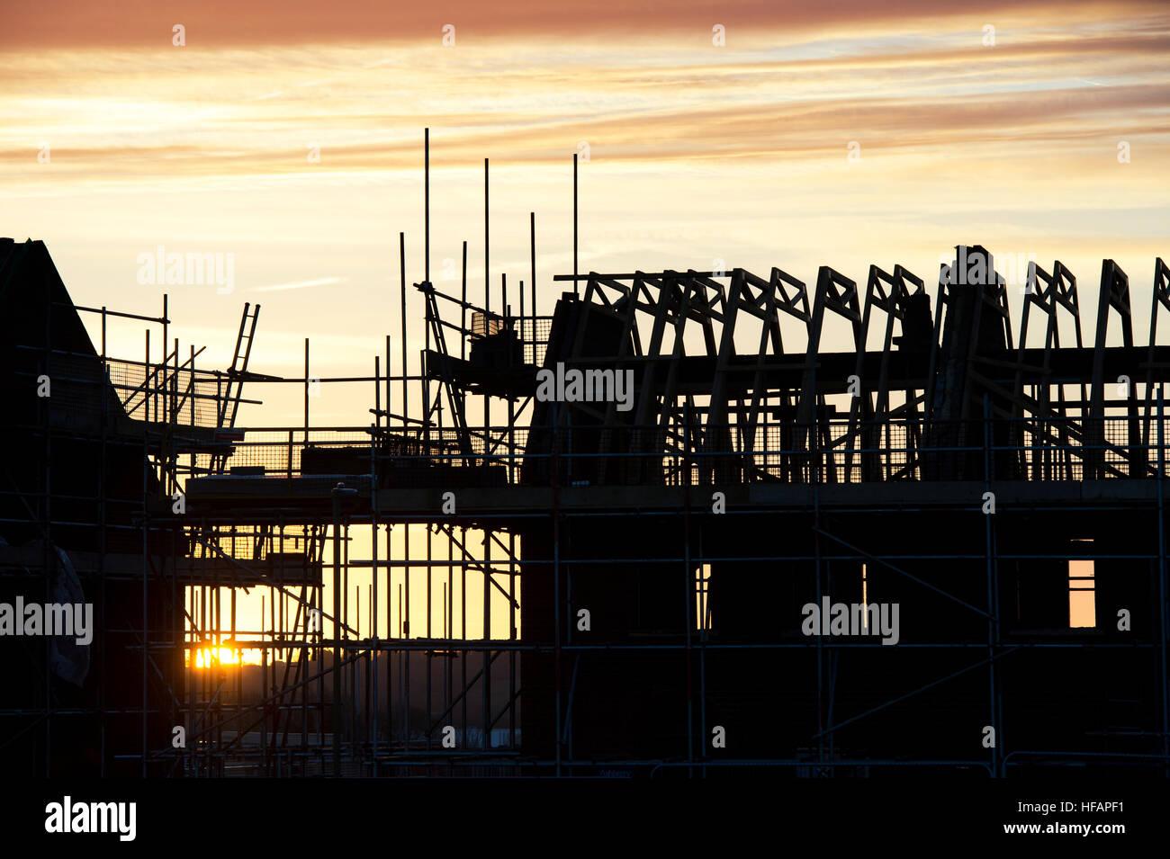 New housing development at sunrise. Silhouette. Banbury, Oxfordshire, England - Stock Image
