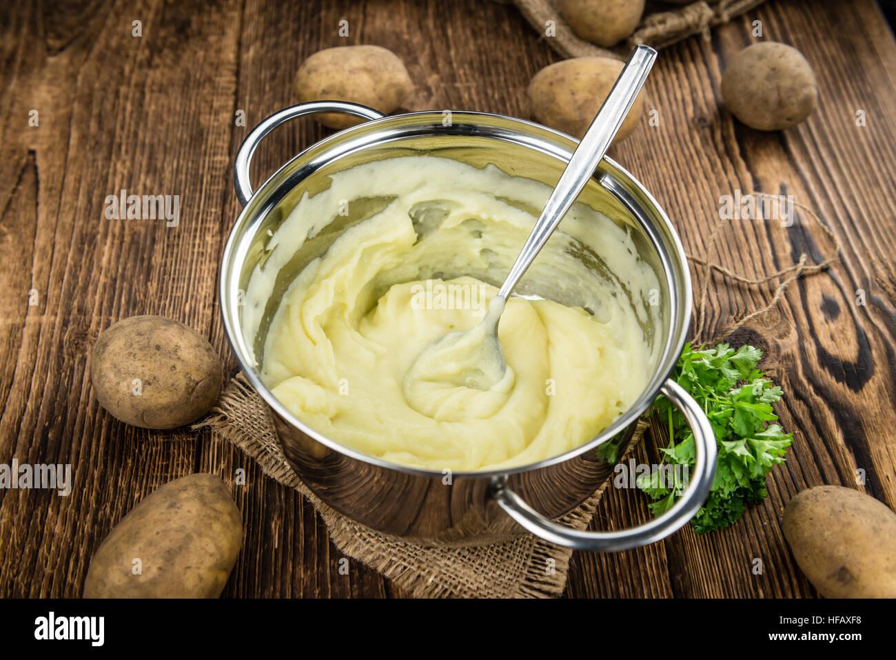 Potato Mash on rustic wooden background (close-up shot) - Stock Image