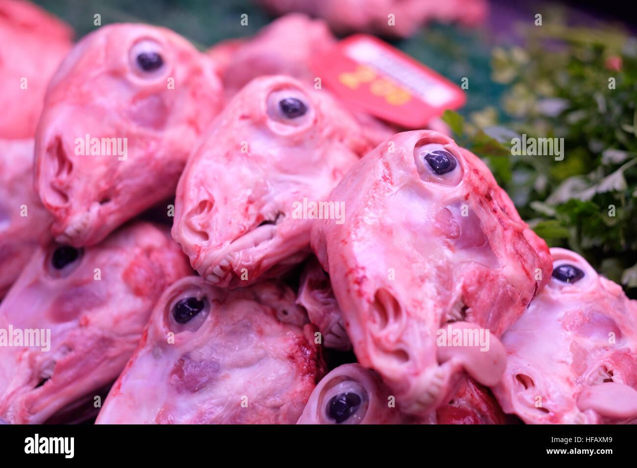 sheep head skinless eyeballs eye tongue butcher - Stock Image