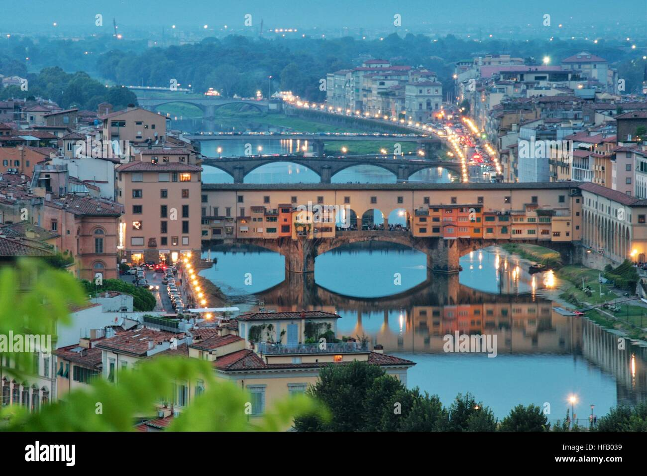 The Ponte Vecchio Bridge crossing the river Arno in Florence, Italy - Stock Image