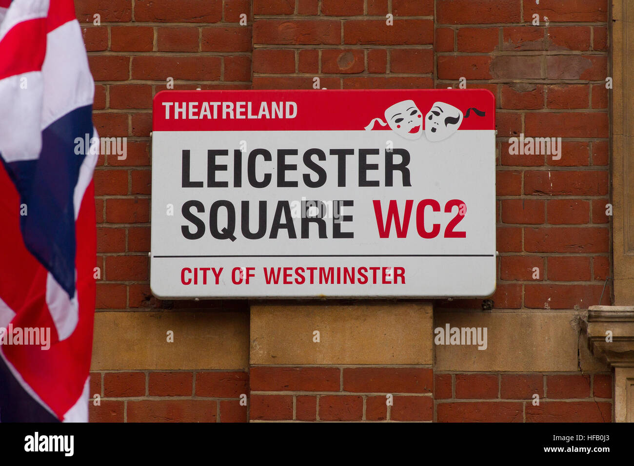General View GV of Leicester Square theatreland street sign with a Union Jack Flag, London WC2 - Stock Image