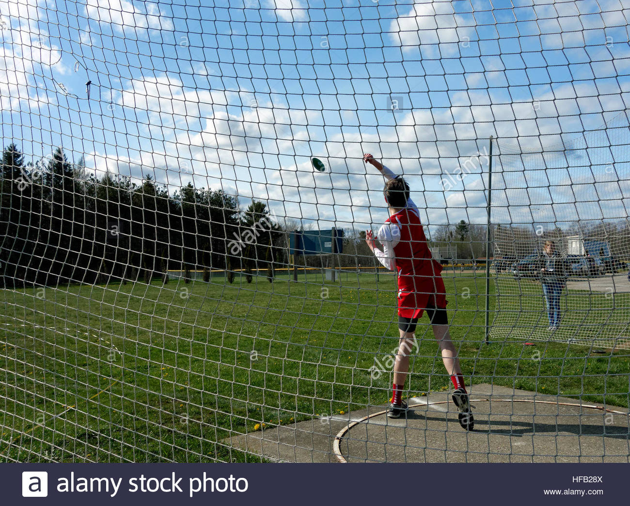 Discus throw at a track meet. - Stock Image