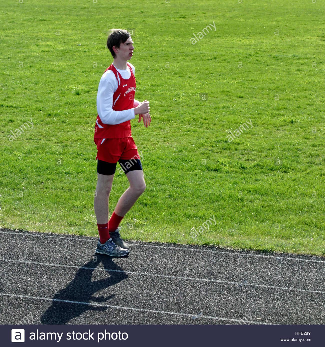 Racewalk at a high school track meet. - Stock Image