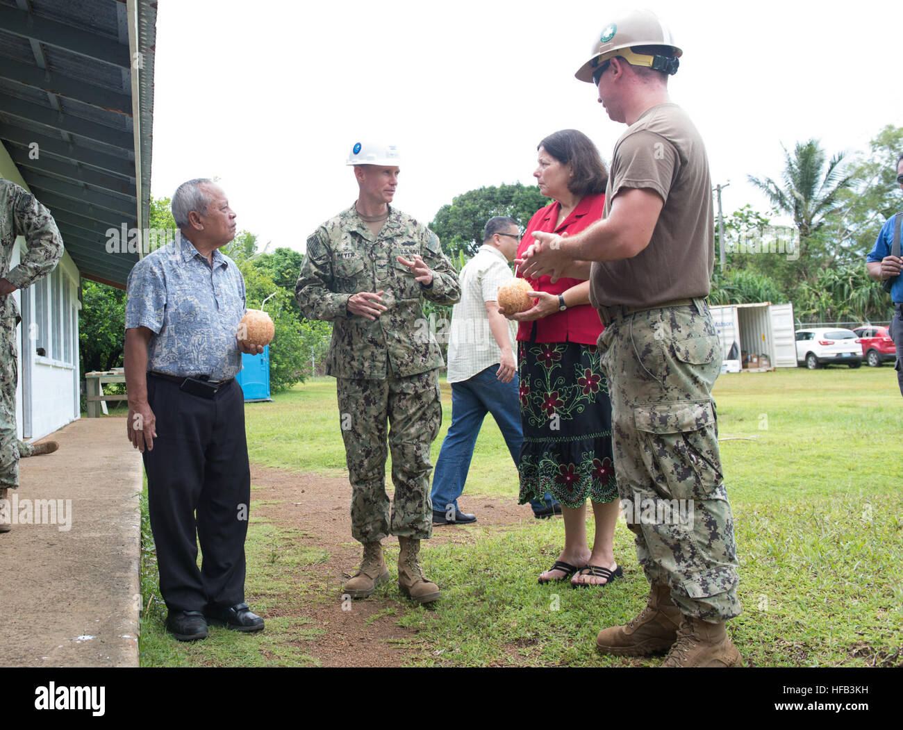 150625-N-RB060-004  POHNPEI (June 25, 2015) - Commdore, Task Force Forager, Capt. James Meyer, discusses school - Stock Image