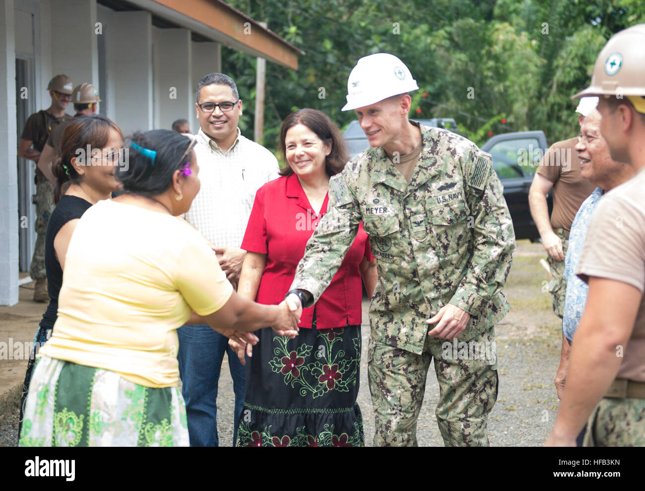 150625-N-RB060-183  POHNPEI (June 25, 2015) - Task Force Forager, Capt. James Meyer, meets with a teacher from Lukop - Stock Image