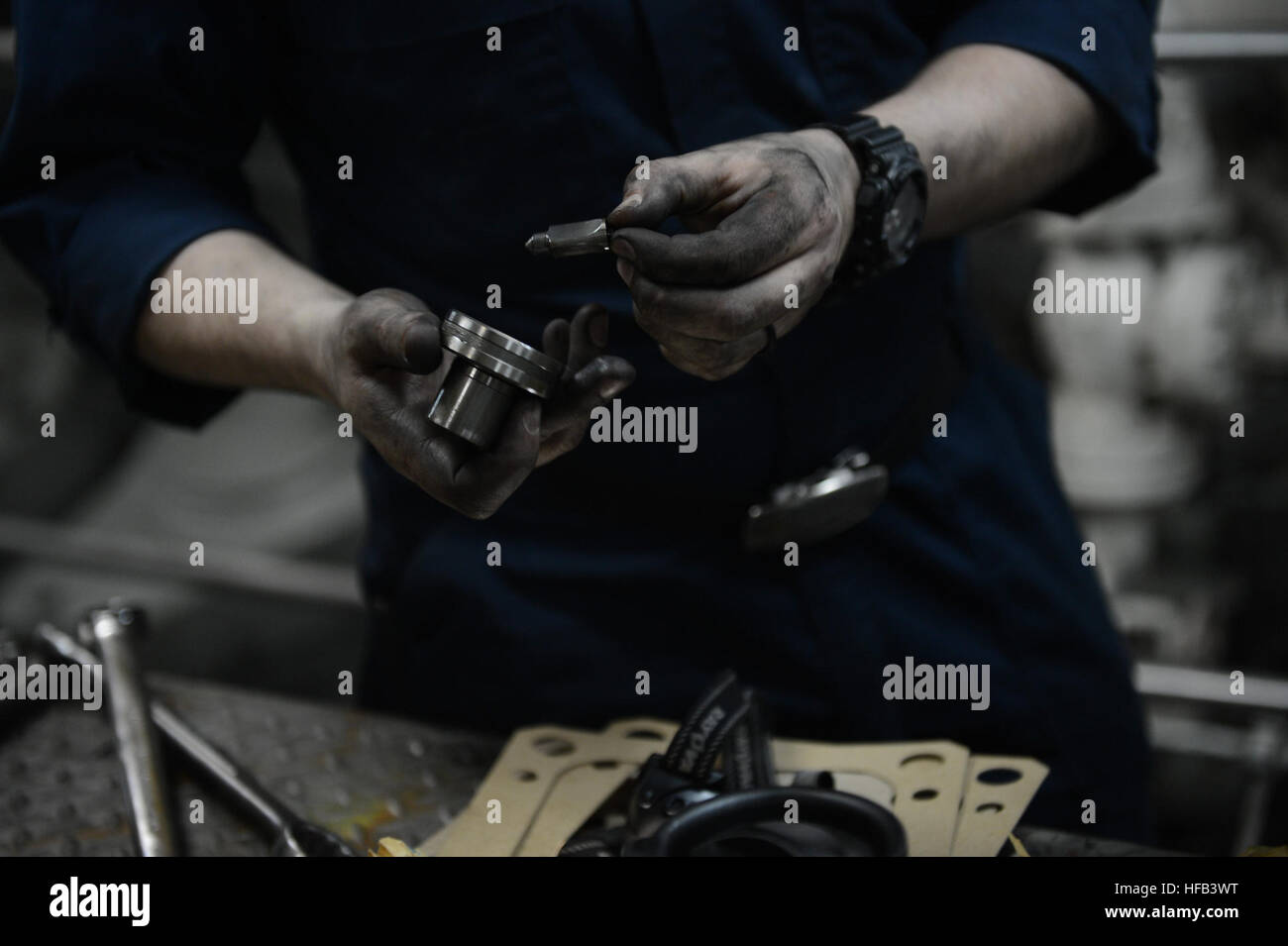 u s navy engineman 3rd class amell trevino holds parts after stock