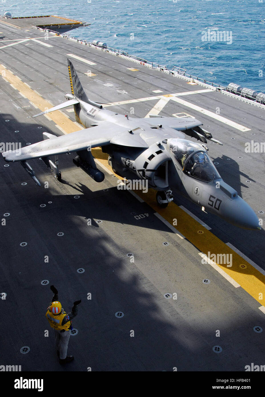 An AV-8B Harrier attached to the Air Combat Element of the 24 Marine Expeditionary Unit taxis forward after landing Stock Photo