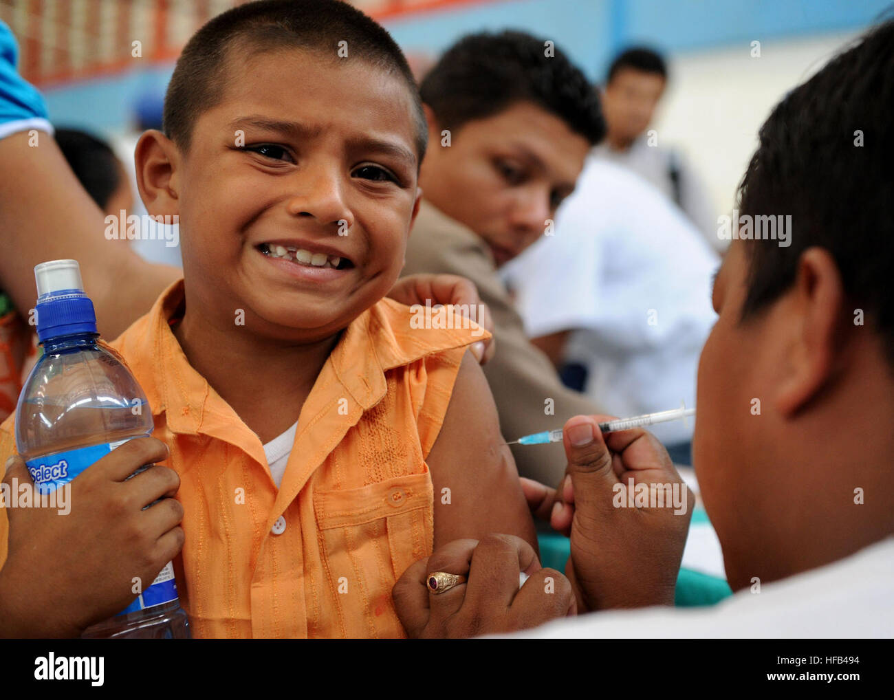 A Costa Rican boy receives a shot from a Costa Rican nurse during a Pacific Partnership 2010 community service event. - Stock Image