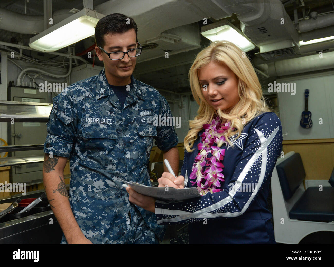 Dallas cowboys cheerleader samantha melissa right signs her stock dallas cowboys cheerleader samantha melissa right signs her autograph for ships serviceman 2nd class antonio rodriguez assigned to the guided missile m4hsunfo