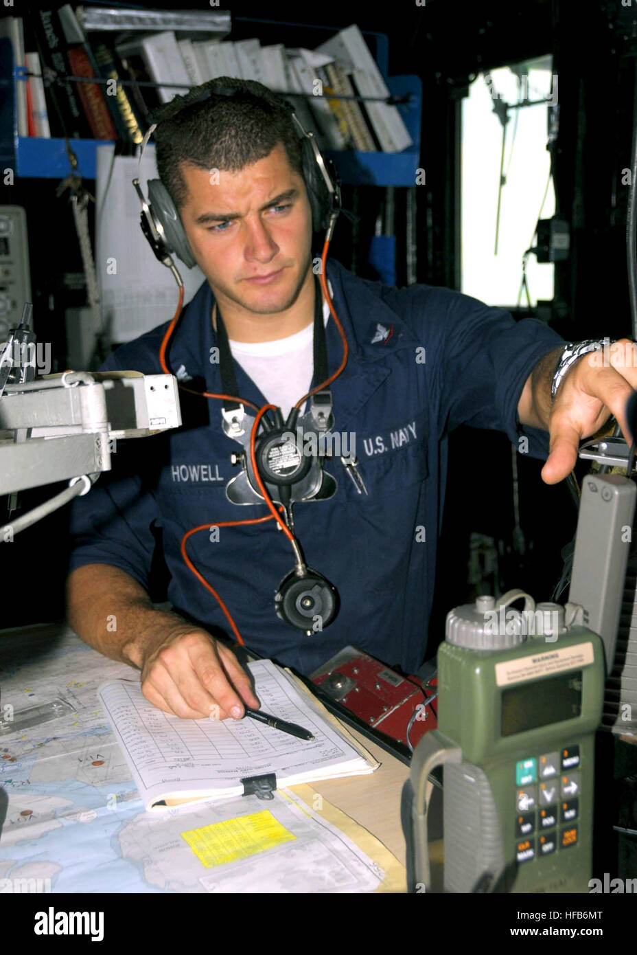 us navy quartermaster 3rd class russell j howell checks the reading from a global positioning system aboard uss harpers ferry lsd 49 may 11 2008