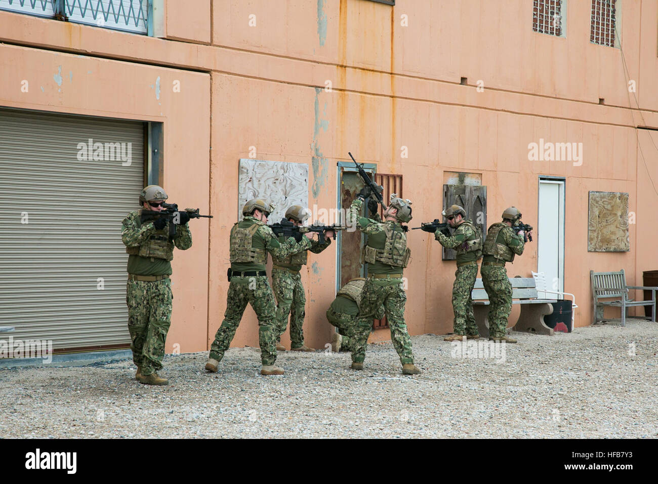 Explosive Ordnance Disposal Technicians conduct a door breach training evolution at Joint Expeditionary Base Little Creek-Fort Story Jan. 29. & Explosive Ordnance Disposal Technicians conduct a door breach Stock ...